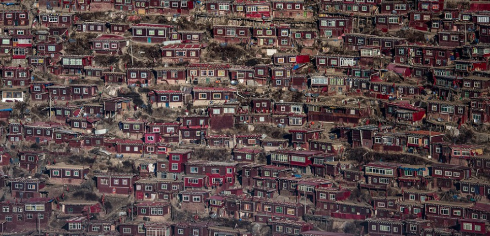 This picture taken on December 8, 2015 shows homes of Buddhist nuns and monks from the Larung Gar Buddhist Institute in Sertar county (known as Seda in Chinese) in the remote Garze Tibetan Autonomous Prefecture in southwest China's Sichuan province. The monastery founded in 1980 has become one of the largest and most influential centres for the study of Buddhism with up to 40,000 monks and nuns in residence for parts of the year. AFP PHOTO / FRED DUFOUR / AFP / FRED DUFOUR