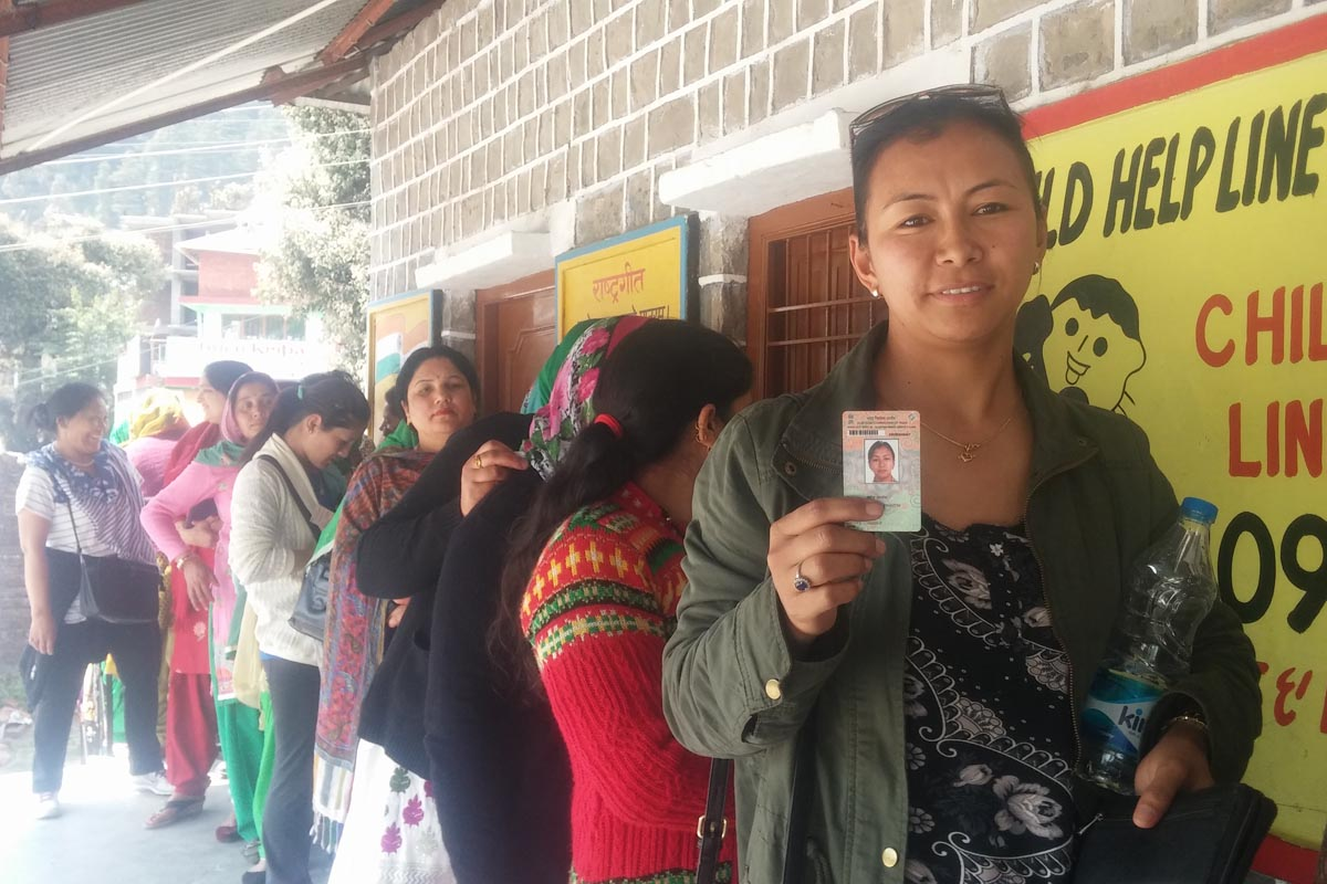 Exile Tibetan Tsering Yangzom, 36, standing in queue to cast her vote to elect a member to the Dharamshala Municipal Corporation, in Bhagsu Nag, India, on 27 March 2016. Yangzom cast vote for the first time in an Indian election after Tibetans were given the right to vote in 2014.
