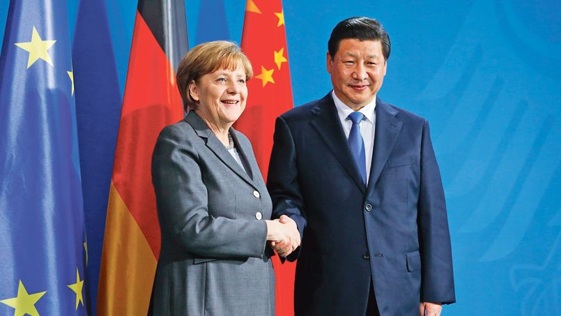 German Chancellor Angela Merkel and China's President Xi Jinping shakes hands following a joint news conference after an agreement signing, at the Chancellery in Berlin March 28, 2014.                         REUTERS/Fabrizio Bensch (GERMANY  - Tags: POLITICS)   - RTR3J0J9