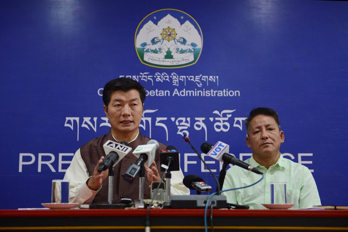 Sikyong Lobsang Sangay speaks during a press conference, as Finance Minister of the Central Tibetan Administration, Karma Yeshi, look on, in Dharamshala, India, on 3 October 2016.